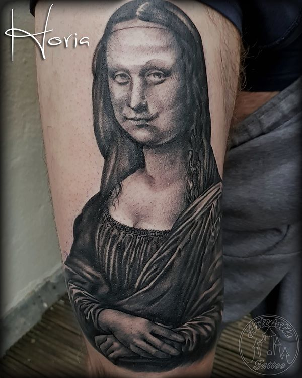 ArtCastleTattoo Tattoo ArtiestHoria Black n grey Mona Lisa tattoo realistic on upper leg Black n Grey