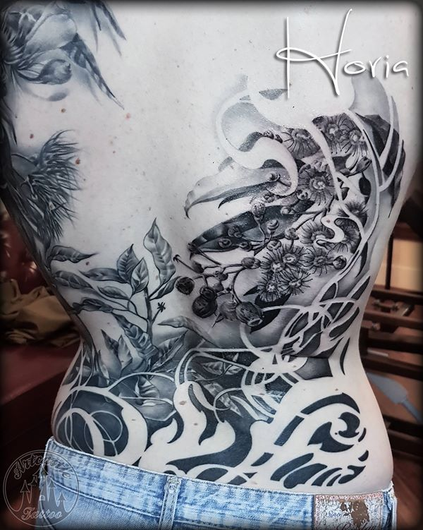 ArtCastleTattoo Tattoo ArtiestHoria Ornamental black n grey backpiece with flowers and beautiful filligree shapes. Work in progress Black n Grey
