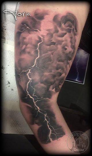 ArtCastleTattoo Tattoo ArtiestHoria Realistic Lightning Bolt black n grey on arm Black n Grey