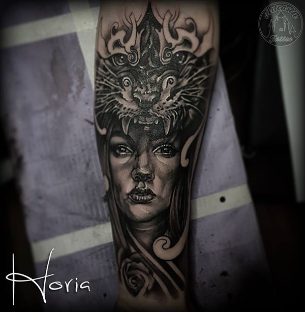 ArtCastleTattoo Tattoo ArtiestHoria Realistic Womans portrait tattoo with tiger lower arm Black n Grey