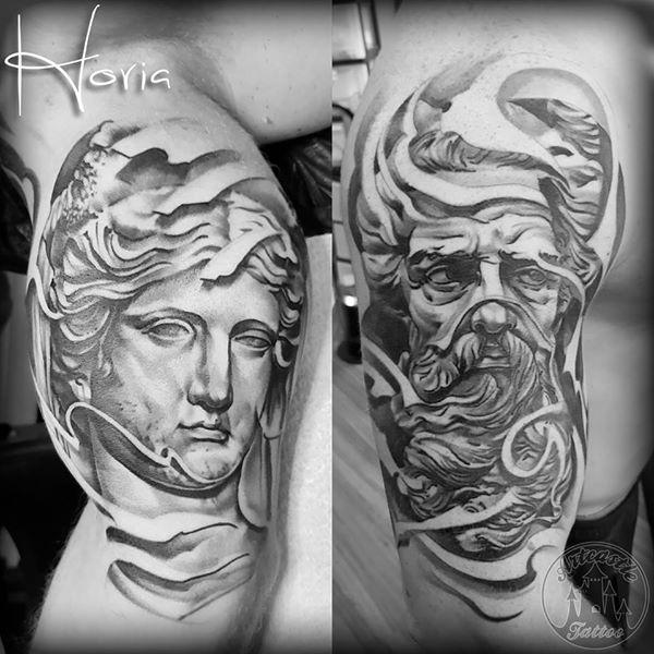 ArtCastleTattoo Tattoo ArtiestHoria Realistic greek statue faces black n grey upper arm Black n Grey