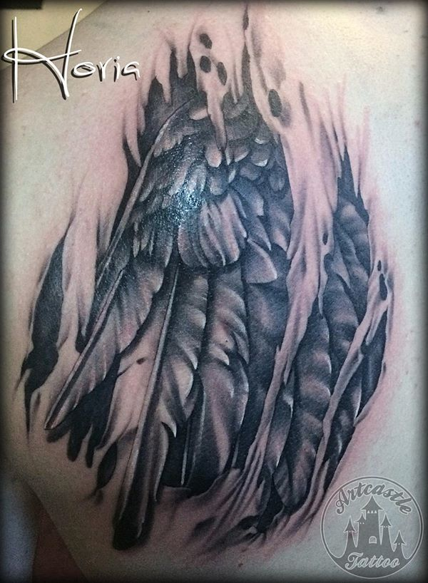 ArtCastleTattoo Tattoo ArtiestHoria Realistic torn flesh tattoo with a realistic wing and feathers black n grey Black n Grey