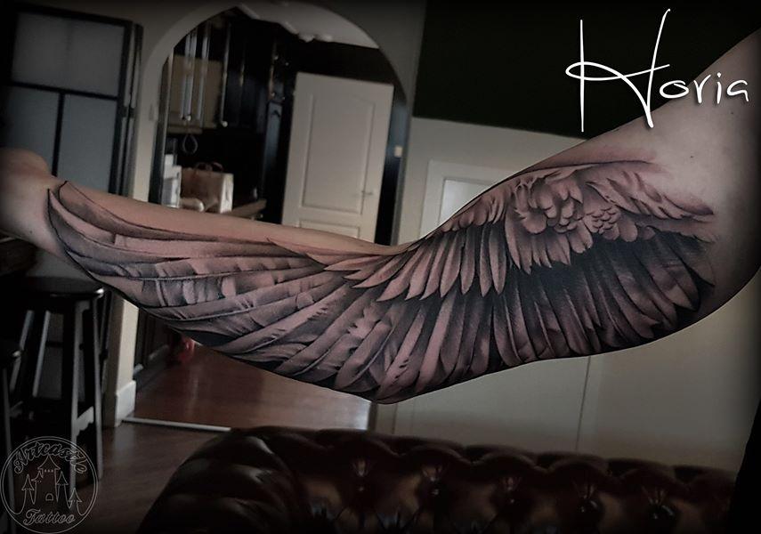 ArtCastleTattoo Tattoo ArtiestHoria Realistic wing tattoo on inner arm Black n Grey