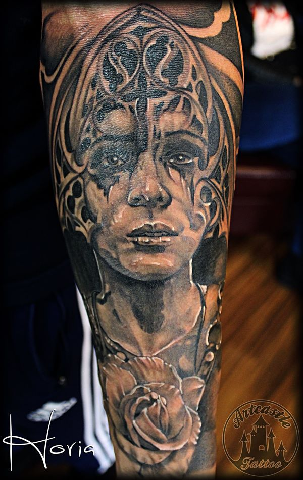 ArtCastleTattoo Tattoo ArtiestHoria Realistic womans portrait church window and rose black n grey on lower arm Portraits