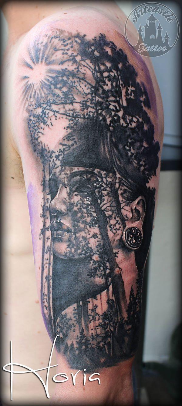 ArtCastleTattoo Tattoo ArtiestHoria Realistic womans portrait tattoo sunshine through trees black n grey upper arm Portrait