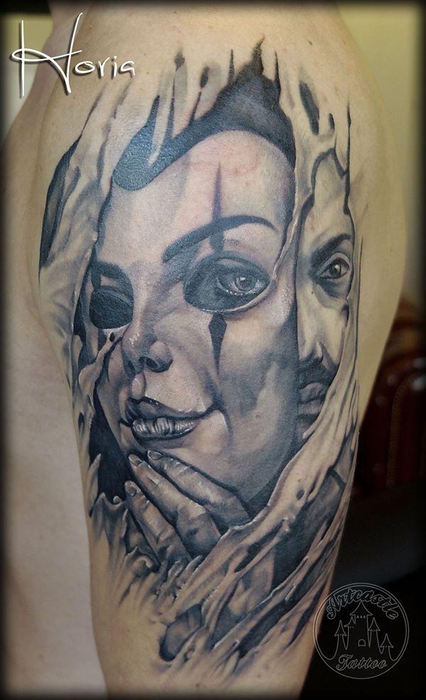 ArtCastleTattoo Tattoo ArtiestHoria Relaistic man portrait with a Mask with ripped Flesh black n grey upper arm Black n Grey