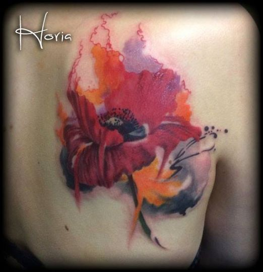 ArtCastleTattoo Tattoo ArtiestHoria Watercolor poppy flower tattoo realistic color on shoulder blade Color