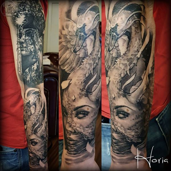 ArtCastleTattoo Tattoo ArtiestHoria Womans face with swan morph in black n grey on lower arm Sleeves
