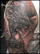 ArtCastleTattoo Tattoo ArtiestHoria Womans portrait with bird head dress black n grey realistic black n grey tattoo Black n Grey