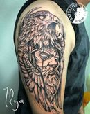 ArtCastleTattoo Tattoo ArtiestIlya Man with bird on arm Blackwork