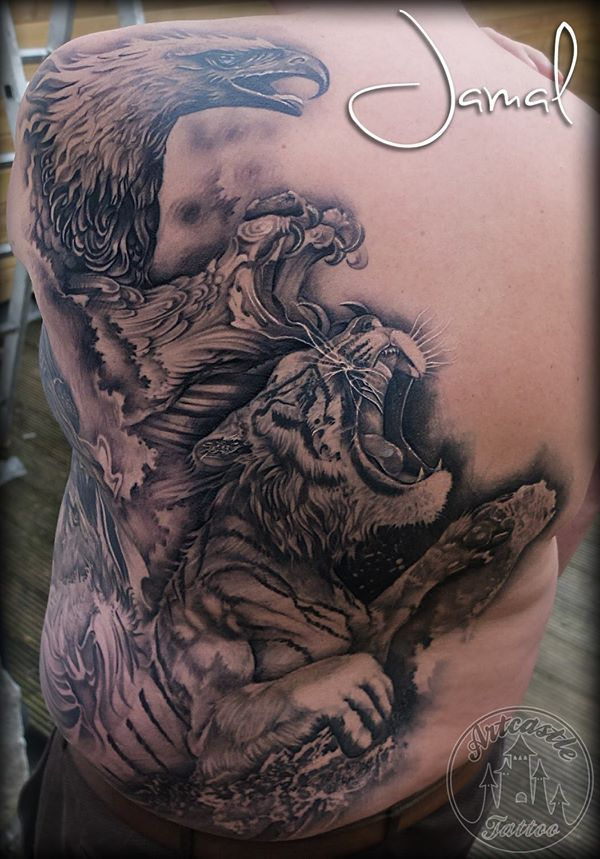 ArtCastleTattoo Tattoo ArtiestJamal Backpiece of a realistic tiger splashing out of the water and a eagle flying out of the clouds. BlacknGrey