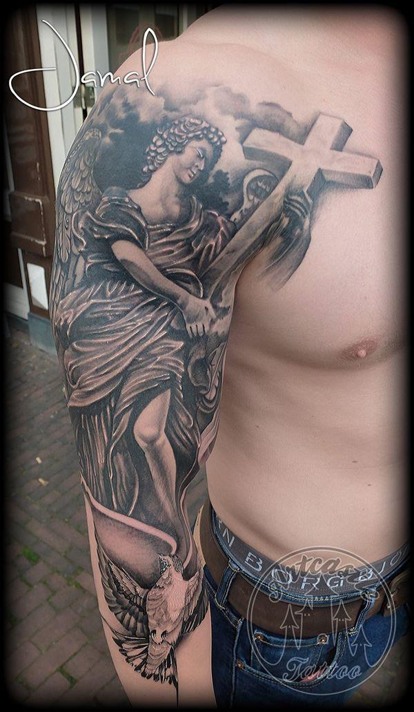 ArtCastleTattoo Tattoo ArtiestJamal Black n Grey Sleeve with a realistic bird and angel holding a cross Sleeves