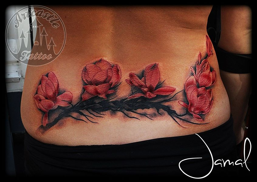 ArtCastleTattoo Tattoo ArtiestJamal Color Blossom tattoo lower back Kleur blossom tattoo onderrug Color