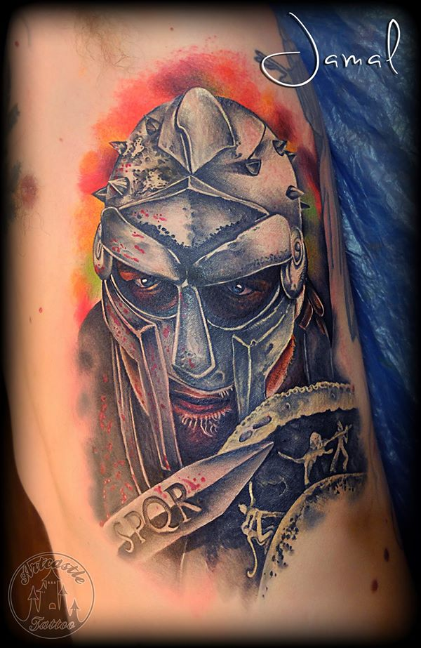 ArtCastleTattoo Tattoo ArtiestJamal Gladiator side piece with armor a blade and a shield. Also color effects in the background Color