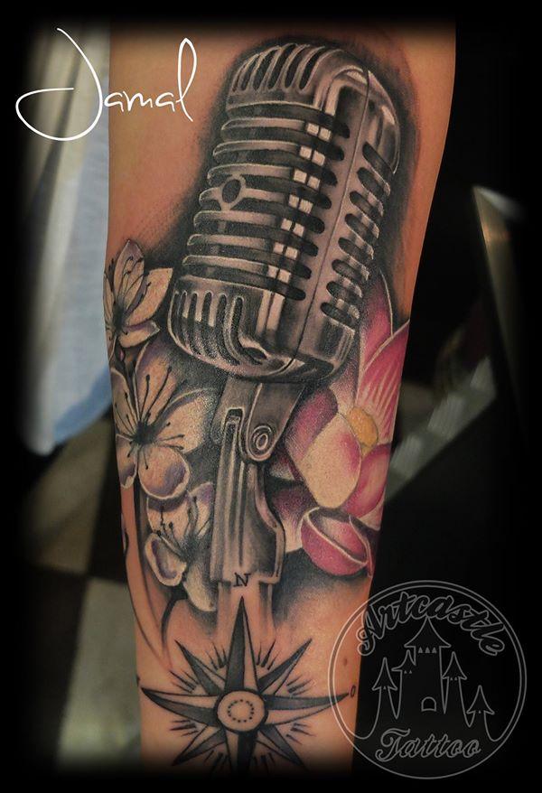 ArtCastleTattoo Tattoo ArtiestJamal Microphone with Flowers with color details Black n Grey