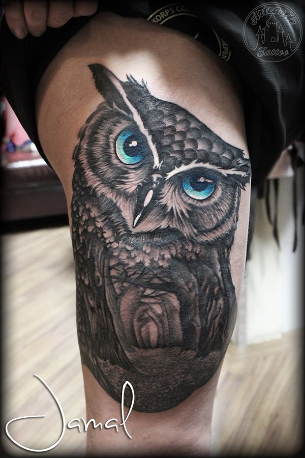 ArtCastleTattoo Tattoo ArtiestJamal Owl with forest scene inside tattoo bright blue eyes on upper leg Black n Grey