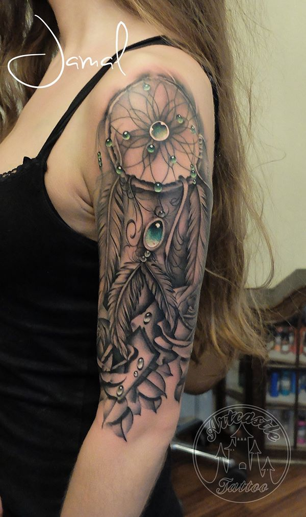 ArtCastleTattoo Tattoo ArtiestJamal Realistic Dreamcatcher half sleeve with roses and emerald stones. Black n Grey
