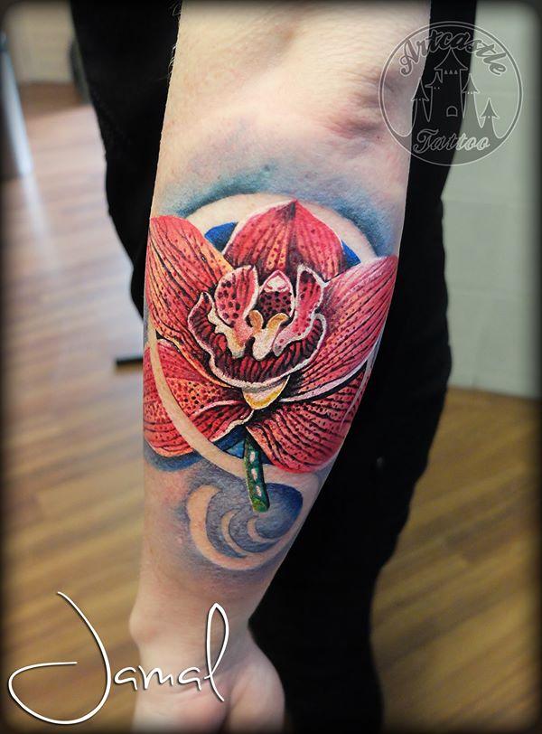 ArtCastleTattoo Tattoo ArtiestJamal Realistic Orchid flower tattoo with blue background Full Color