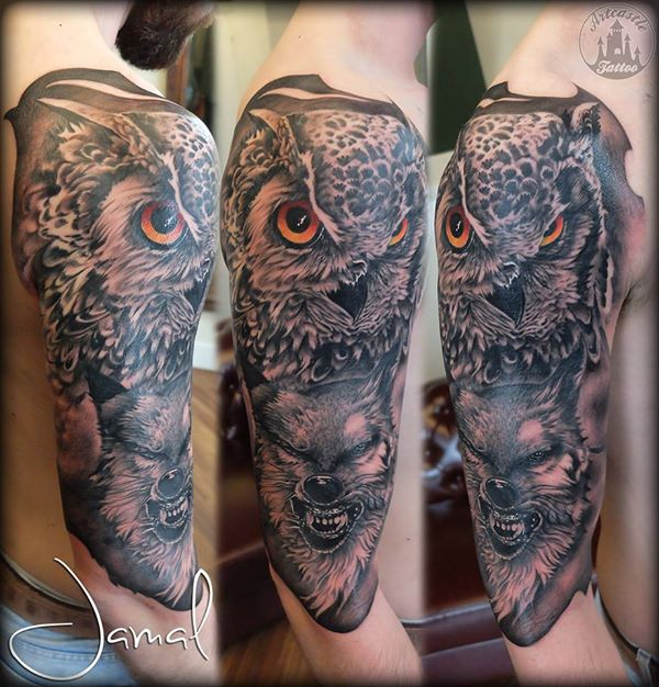 ArtCastleTattoo Tattoo ArtiestJamal Realistic Owl and Wolf half sleeve tattoo with colored eyes and Black n Grey