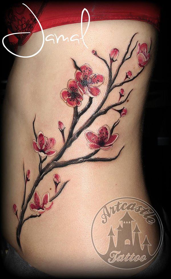 ArtCastleTattoo Tattoo ArtiestJamal Realistic color cherry blossom branch tattoo on side Kleur realistisch kersenbloesem tak tattoo op zij Color