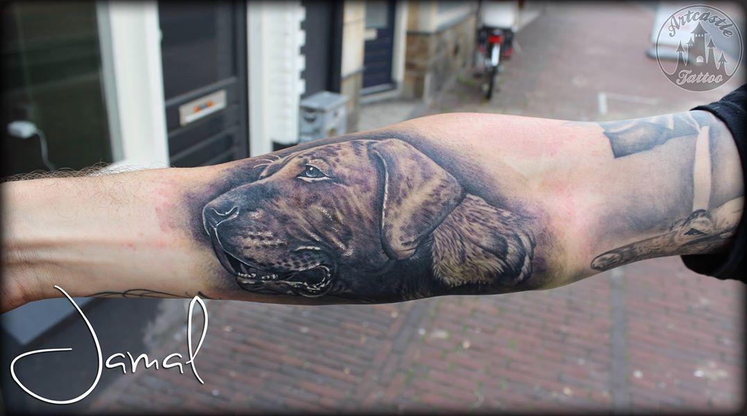ArtCastleTattoo Tattoo ArtiestJamal Realistic dog portrait in black n grey on the underarm Black n Grey