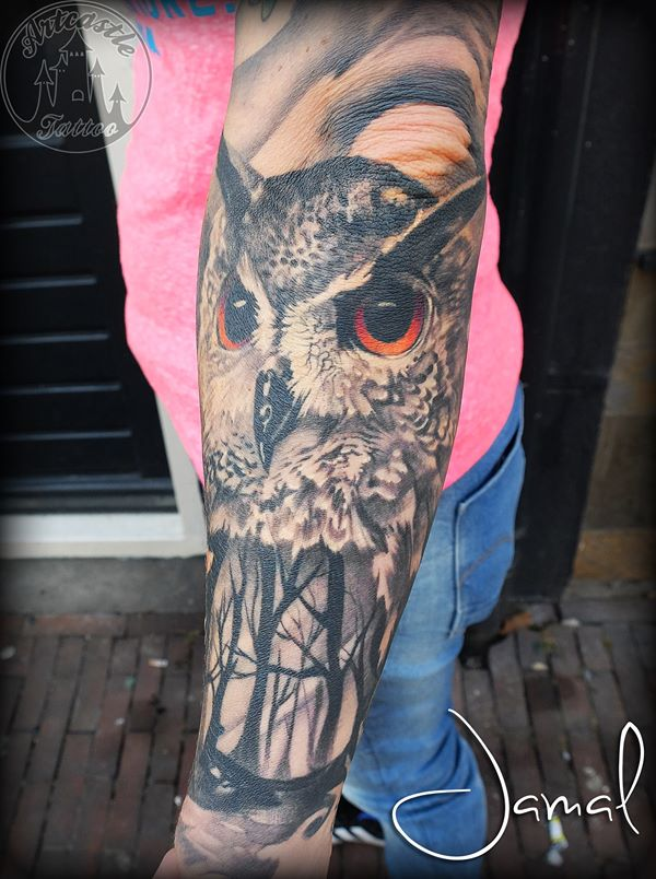 ArtCastleTattoo Tattoo ArtiestJamal Realistic owl and forest with color eyes tattoo lower arm Black n Grey