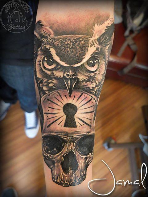 ArtCastleTattoo Tattoo ArtiestJamal Realistic owl tattoo with realistic skull and a keyhole Black n Grey