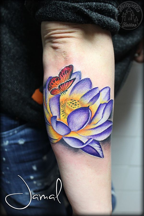 ArtCastleTattoo Tattoo ArtiestJamal Vibrant purple lotus that wraps around the arm with butterfly Color