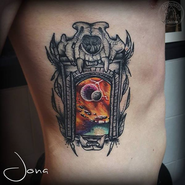 ArtCastleTattoo Tattoo ArtiestJona Blackwork doorway with skull and Galaxy in full color on ribs Color