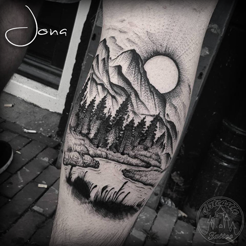 ArtCastleTattoo Tattoo ArtiestJona Blackwork landscape tattoo with rising sun and trees on leg Blackwork