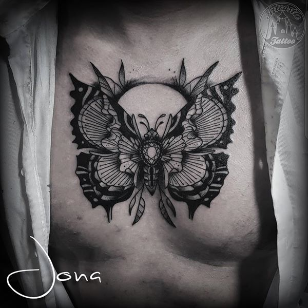 ArtCastleTattoo Tattoo ArtiestJona Jewel butterfly tattoo on chest in blackwork Blackwork