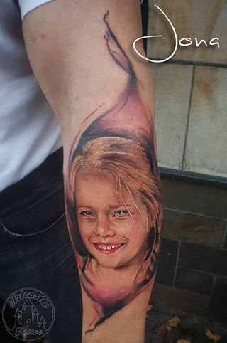 ArtCastleTattoo Tattoo ArtiestJona Realistic portrait of daughter on arm with lifelike colors Portrait