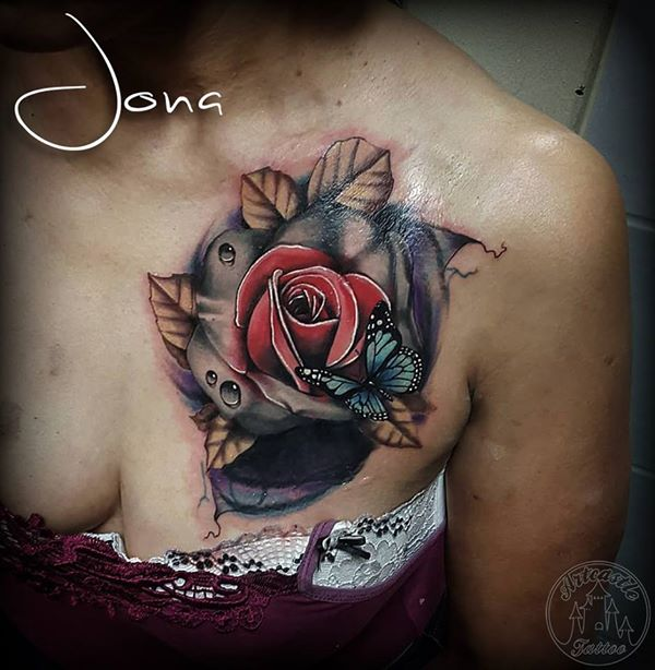 ArtCastleTattoo Tattoo ArtiestJona Realistic rose with blue butterfly used as a cover up on the chest. Color