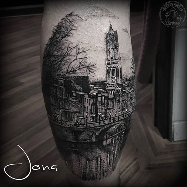 ArtCastleTattoo Tattoo ArtiestJona Utrecht landscape Dom tower and the canals in realistic blackwork on the calf Blackwork