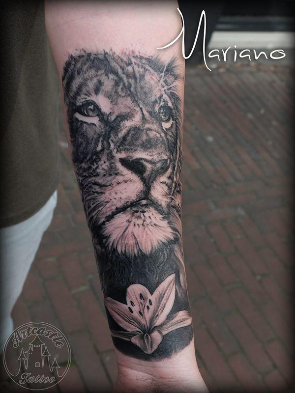 ArtCastleTattoo Tattoo ArtiestMariano Realistic Lion with lily tattoo underarm Black n Grey