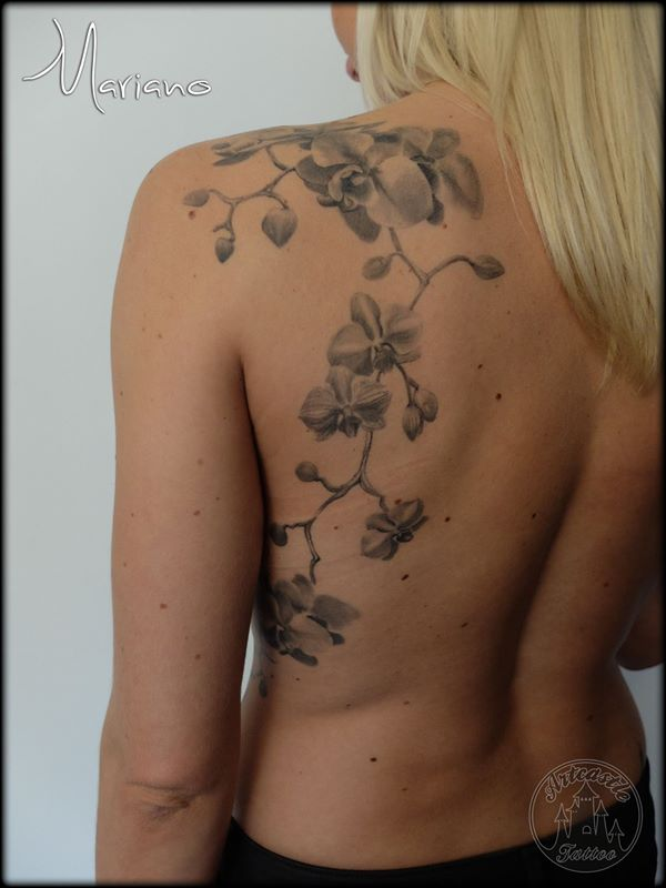 ArtCastleTattoo Tattoo ArtiestMariano Realistic Orchid flowers on back shoulder Black n Grey