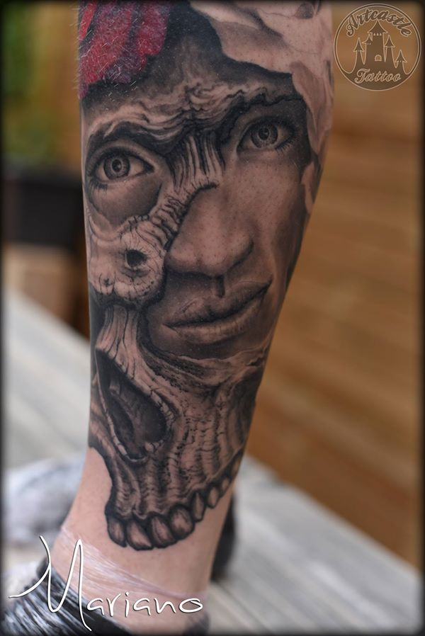 ArtCastleTattoo Tattoo ArtiestMariano Realistic face morphed with skull tattoo lower leg Black n Grey