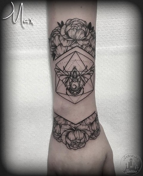 ArtCastleTattoo Tattoo ArtiestMax Blackwork beetle with geometric design and flowers on lower arm Black n Grey