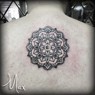 ArtCastleTattoo Tattoo ArtiestMax Blackwork flower mandala on upper back with dotwork shading and details Mandala