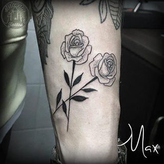 ArtCastleTattoo Tattoo ArtiestMax Blackwork roses with some dot shading and black leaves on the arm Blackwork