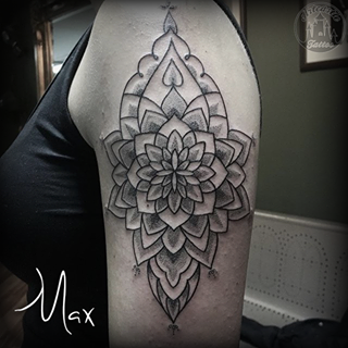 ArtCastleTattoo Tattoo ArtiestMax Large decorative mandala on the upper arm with clean lines and dotwork shading Mandala