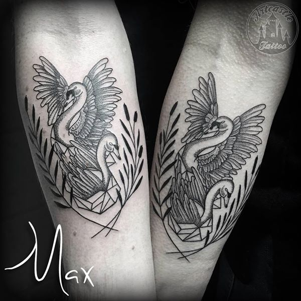 ArtCastleTattoo Tattoo ArtiestMax Matching couple swan tattoos with geometric dotwork and blackwork elements on lower arm Dotwork