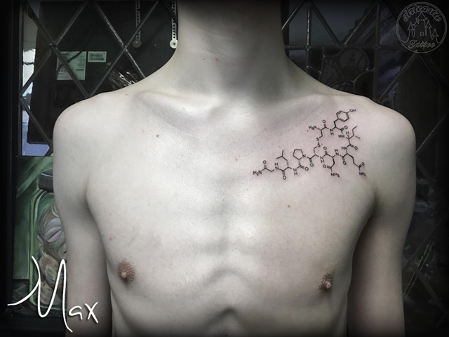 ArtCastleTattoo Tattoo ArtiestMax Molecule tattoo tight fine lines on upper chest Blackwork