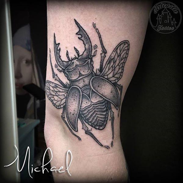 ArtCastleTattoo Tattoo ArtiestMichael Black n grey beetle tattoo on upper arm Blackwork