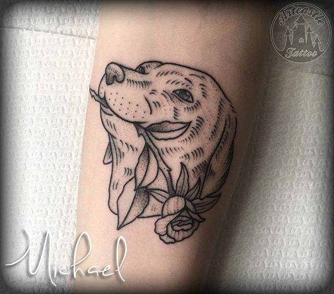 ArtCastleTattoo Tattoo ArtiestMichael Dog with rose on lower arm. Tradtioneel Traditional