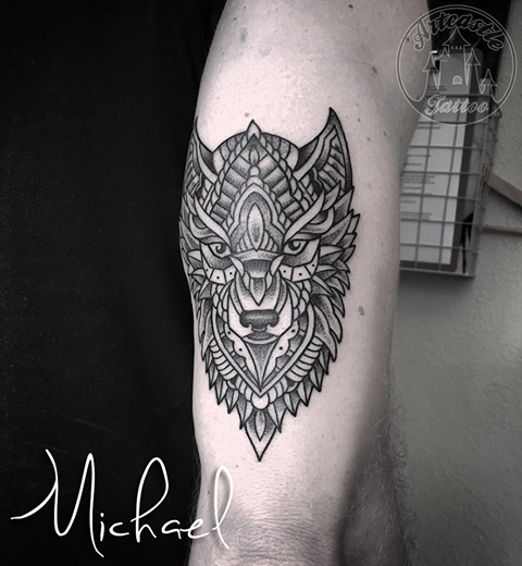 ArtCastleTattoo Tattoo ArtiestMichael Geometric mandala Wolf tattoo on arm black n grey Geometric