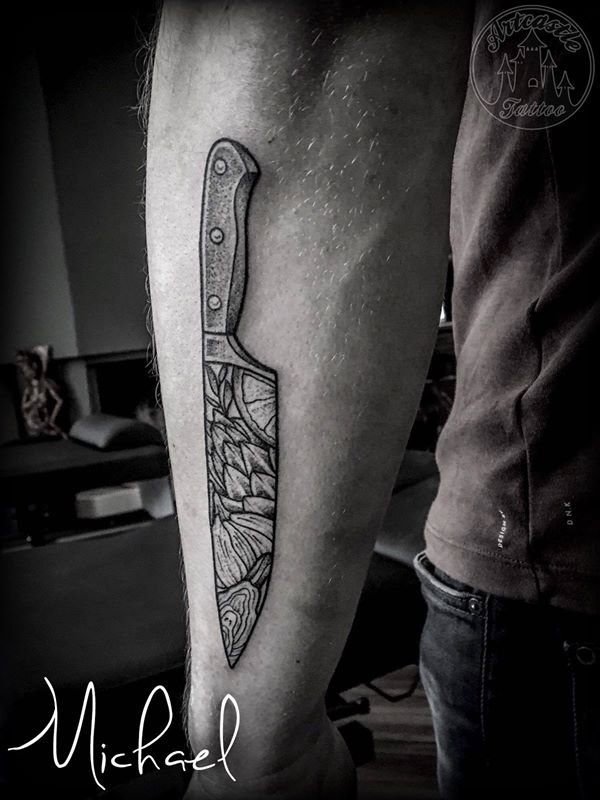 ArtCastleTattoo Tattoo ArtiestMichael Old school traditional blackn grey chef knife tattoo with vegetables inside blade on lower arm Blackwork