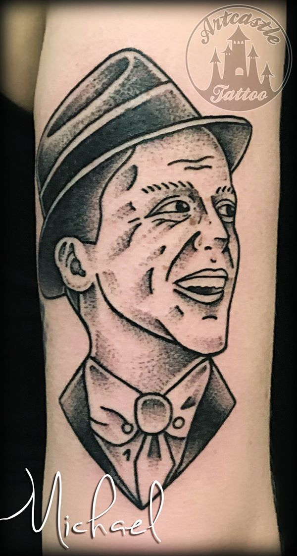 ArtCastleTattoo Tattoo ArtiestMichael Traditional Portrait of Frank Sinatra tattoo black n grey on arm Traditioneel portret op Frank Sinatra tattoo black and grey op arm Old School