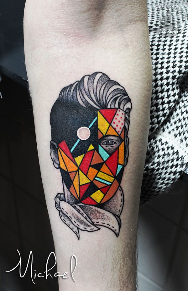 ArtCastleTattoo Tattoo ArtiestMichael Traditional face portrait with creative colored geometric shapes in the face and graphic design Old School
