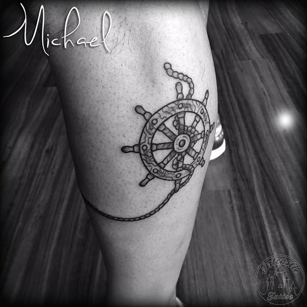 ArtCastleTattoo Tattoo ArtiestMichael Traditional ship wheel tattoo black n grey on lower leg Old School